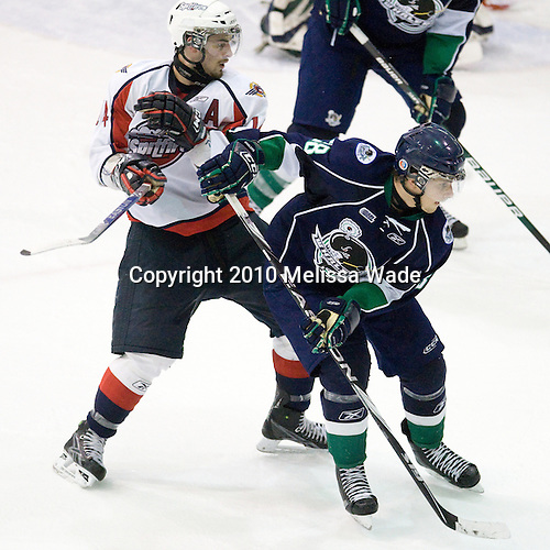 Adam Henrique (Windsor - 14), Phil McRae (Plymouth - 38) - The Windsor Spitfires defeated the Plymouth Whalers 3-2 (OT) to sweep the Ontario Hockey League Western Conference Semi-Finals on Wednesday, April 7, 2010, at Compuware Arena in Plymouth, Michigan.