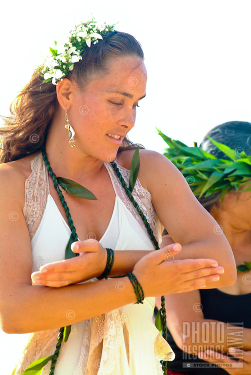 Young local bride performing hula at her wedding on Ke'iki Beach, North Shore