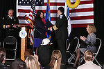 Yolanda Garcia, with U.S. Sen. Harry Reid's office, congratulates Carson City Fire Chief Bob Schreihans at his badge-pinning ceremony at Station 51 in Carson City, Nev., on Tuesday, Feb. 3, 2015. <br /> Photo by Cathleen Allison