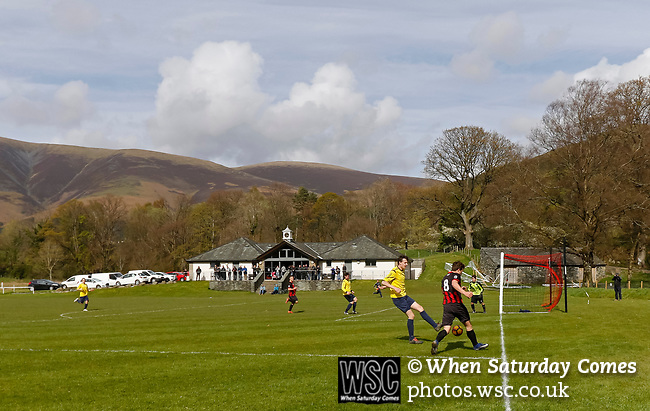 Keswick 1 Kendal 1, 15/04/2017. Fitz Park, Westmoreland League. the Kendal no. 8 crosses the bal. Photo by Paul Thompson.