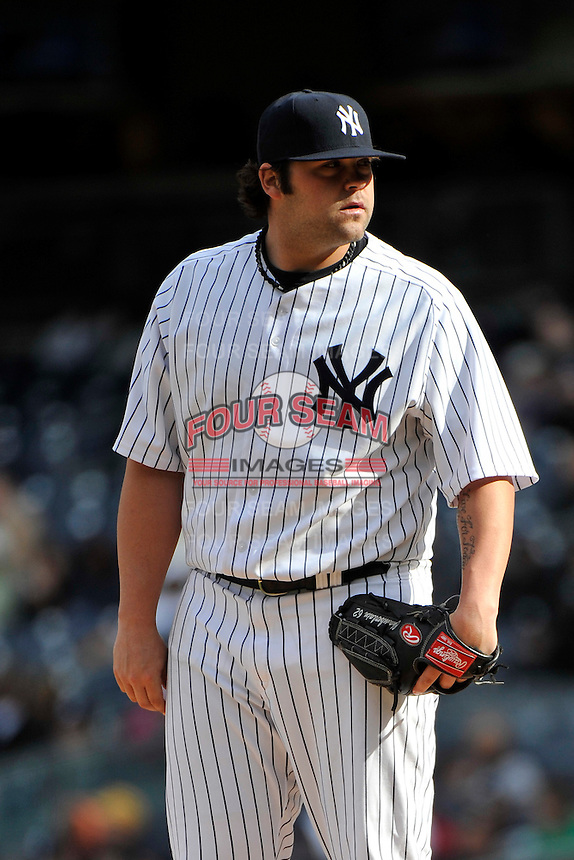 Apr 03, 2011; Bronx, NY, USA; New York Yankees pitcher Joba Chamberlain (62) during game against the Detroit Tigers at Yankee Stadium. Tigers defeated the Yankees 10-7. Mandatory Credit: Tomasso De Rosa