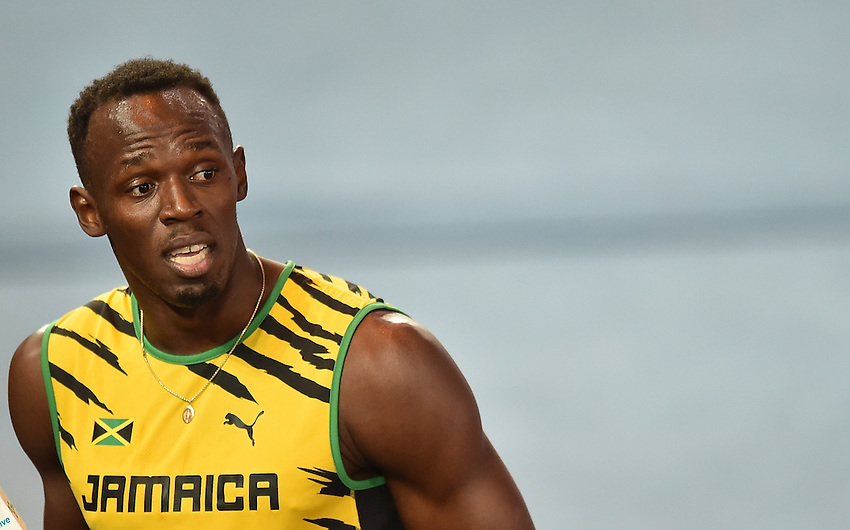 Jamaica's Usain Bolt after the men's 4x100m relay heat 2<br /> <br /> Photographer Chris Vaughan/CameraSport<br /> <br /> 20th Commonwealth Games - Day 9 - Friday 1st August 2014 - Athletics - Hampden Park - Glasgow - UK<br /> <br /> &copy; CameraSport - 43 Linden Ave. Countesthorpe. Leicester. England. LE8 5PG - Tel: +44 (0) 116 277 4147 - admin@camerasport.com - www.camerasport.com