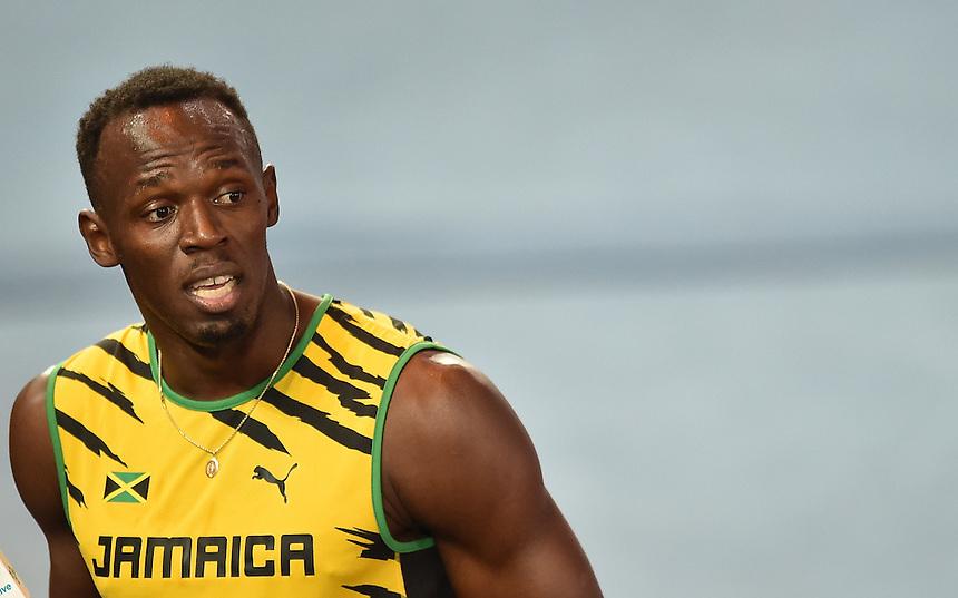 Jamaica's Usain Bolt after the men's 4x100m relay heat 2<br /> <br /> Photographer Chris Vaughan/CameraSport<br /> <br /> 20th Commonwealth Games - Day 9 - Friday 1st August 2014 - Athletics - Hampden Park - Glasgow - UK<br /> <br /> &copy; CameraSport - 43 Linden Ave. Countesthorpe. Leicester. England. LE8 5PG - Tel: +44 (0) 116 277 4147 - admin@camerasport.com - www.camerasport.com