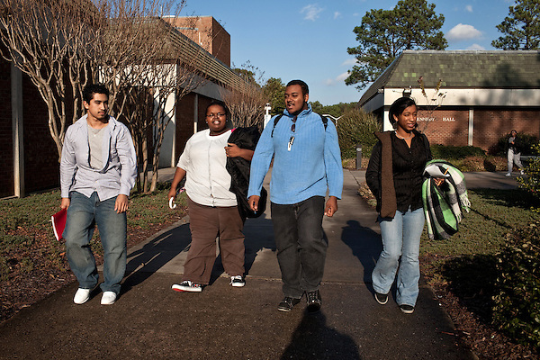 December 09, 2009. Pinehurst, North Carolina.. Students in the SandHoke Early College High School attend classes at Sandhills Community College for their last year of high school and will graduate with a high school diploma, as well as an associates degree.. (left to right) Javier Cruz, Tiana Purcell, Brandon McLean and Vilma Acosta walk through campus after their biology class.