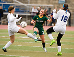 MIDDLETOWN, CT-111817JS20- Holy Cross' McKenna Ellsworth (2) goes for the ball between Old Lyme's Julia Smith (11) and Caroline Wallace (18) during their Class S state final game Saturday at Middletown High School.<br /> Jim Shannon Republican-American