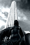 Black and white of a bronze statue in front of Rockefeller Center, Manhattan, New York City.