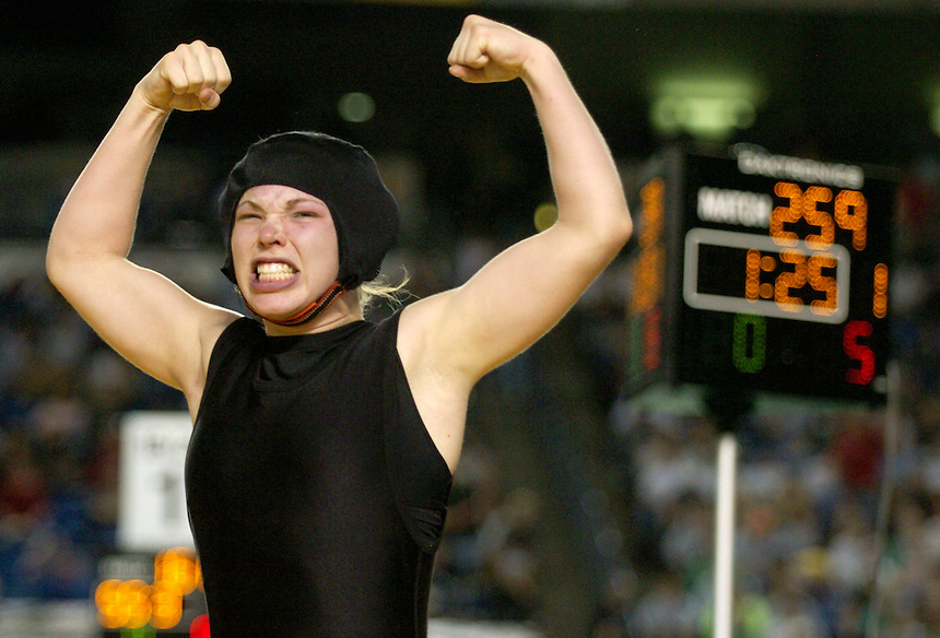 Mount Bakerís Ashlee Phy flexes her arms, celebrating her victory over Skylineís Alexis Willcher for the 145-pound girls championship title as well as a team title for the Mount Baker girls team during the 2008 Mat Classic XX wrestling state championship at the Tacoma Dome on Saturday, February 16, 2007. In order for Mount Bakerís girls team to win the state title, Phy needed to win by a pin and she did.