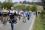 The peloton arrive at the feed zone in Pozzo Sant'Evasio during the 2015 96th Milan-Turin 186km race starting at San Giuliano Milanese, Italy. 1st October 2015.<br /> Picture: Eoin Clarke | Newsfile
