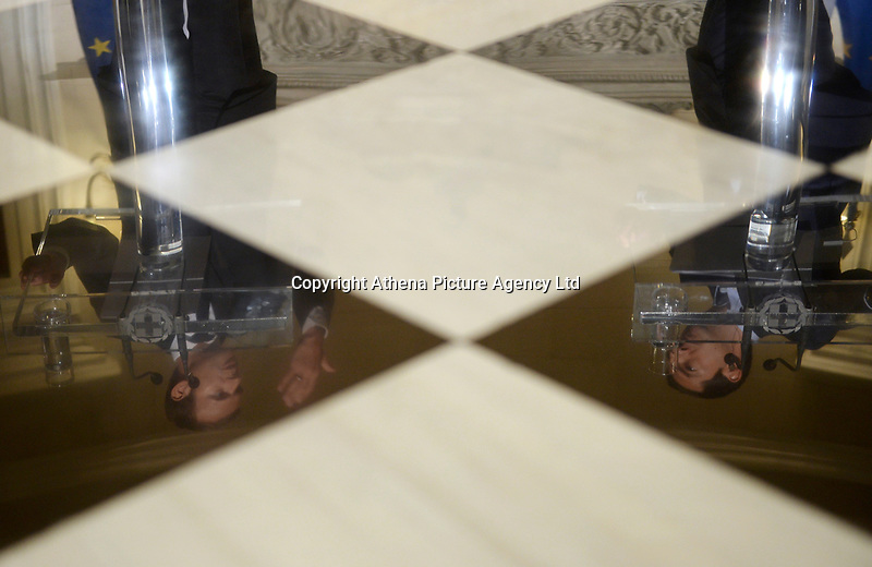 Pictured: (L-R) The reflections of French President Emmanuel Macron and Greek Prime Minister Alexis Tsipras on the polished marble floor of Maximos Mansion in Athens, Greece. Thurday 07 September 2017<br /> Re: French President Emmanuel Macron state visit to Athens, Greece.