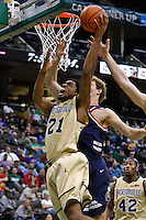 February 03, 2011:    Jacksonville Dolphins forward Delwan Graham (21) goes up for a layup while being guarded by Belmont Bruins forward Trevor Noack (30) during Atlantic Sun Conference action between the Jacksonville Dolphins and the Belmont Bruins at Veterans Memorial Arena in Jacksonville, Florida.  Belmont defeated Jacksonville 76-70.