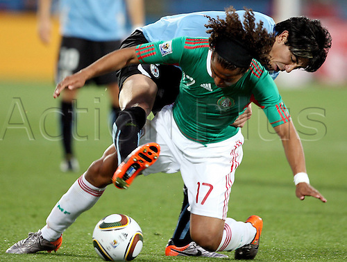 22 06 20102010 FIFA World Cup, Mexico v Uruguay, played at the Royal Bafokeng stadium, Rustenburg, South Africa. Picture shows Jorge Fucile Uru and Egidio Arevalo MEX