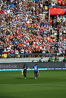 Kane Williamson bumps gloves with Brendon McCullum after the NZ Captain was caught for 77, from 39 deliveries, during the ICC Cricket World Cup one day pool match between the New Zealand Black Caps and England at Wellington Regional Stadium, Wellington, New Zealand on Friday, 20 February 2015. Photo: Dave Lintott / lintottphoto.co.nz