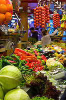 Fruits and vegetables for sale at a market hall in Barcelona, Spain.
