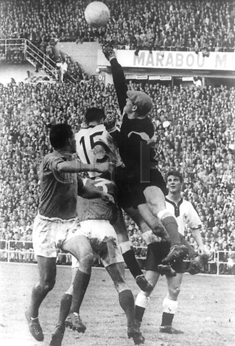 French goalkeeper Abbes (2nd from R, top) punches the crossed ball upfield in front of German forward Alfred Kelbassa (C, no 15) .  Hans Schaefer (R) watches the action, during the 1958 Soccer World Cup match at the Ullevi Stadium in Gothenburg, Sweden, 28 June 1958. The German team lost the match for third place against France by a score of 3-6.