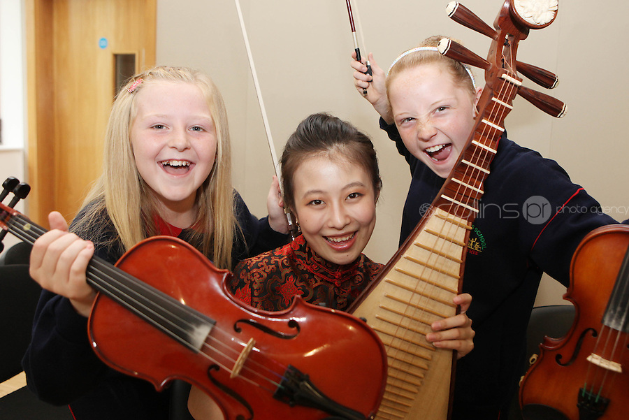 09/09/2011.Jodi Brennan (11) & Chloe Boyle (11).From St Joseph's Senior School, Ballymun, Dublin  & Chineese musican  Chen Bihe in traditional Chinese costume during a vist by the musicans to the school marking the official Irish visit of the Lord Mayor of Beijing, taking place this weekend.Photo: Collins