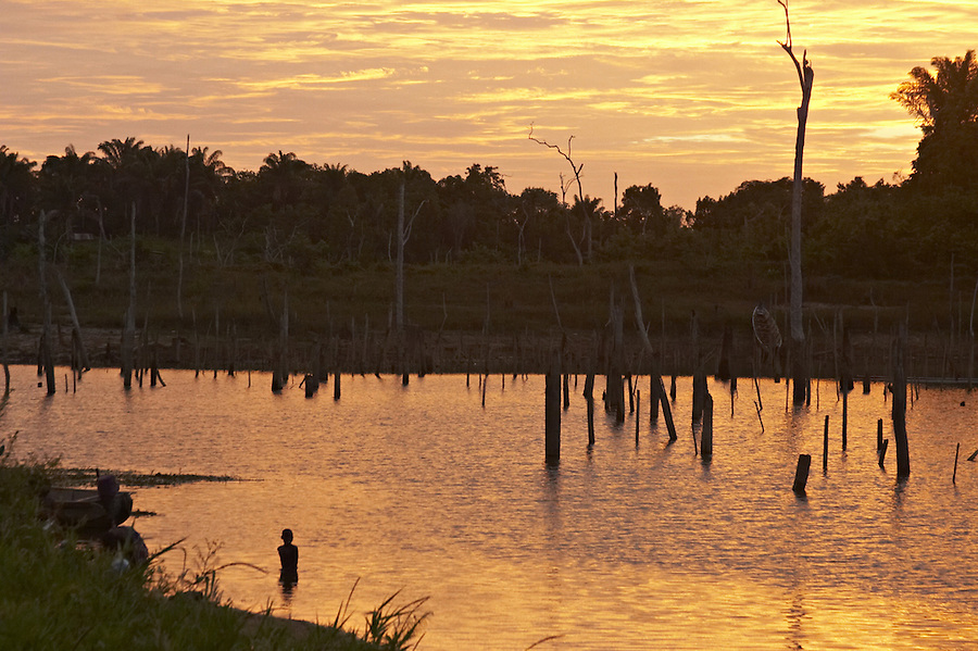 Dawn in the village of Lebidoti on the Brokopondo reservoir in Suriname.  The man-made lake was hastily created by flooding a vast acreage of jungle without any prior logging and evacuation of animals and is reputed to be polluted by mercury from unregulated gold mining..
