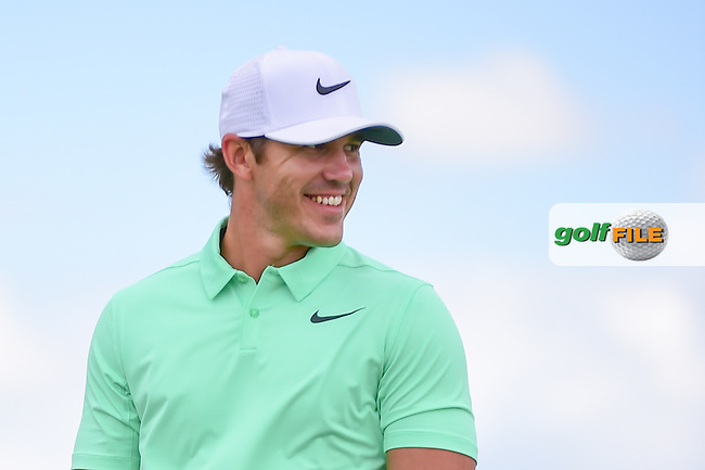 Brooks Koepka (USA) is all smiles as he arrives at the 7th tee during Sunday's round 4 of the 117th U.S. Open, at Erin Hills, Erin, Wisconsin. 6/18/2017.<br /> Picture: Golffile | Ken Murray<br /> <br /> <br /> All photo usage must carry mandatory copyright credit (&copy; Golffile | Ken Murray)