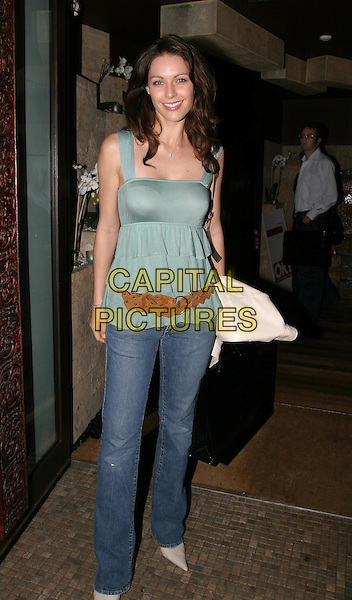 LOUISE GRIFFITHS.Public Players charity party at Taman Gang, Park Lane.17 March 2004.full length, full-length, denim jeans, green aqua floaty vest top, brown belt.www.capitalpictures.com.sales@capitalpictures.com.© Capital Pictures.