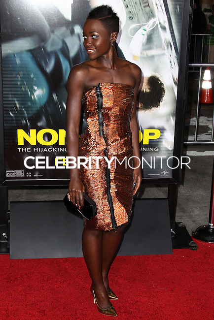 "WESTWOOD, CA, USA - FEBRUARY 24: Lupita Nyong'o at the World Premiere Of Universal Pictures And Studiocanal's ""Non-Stop"" held at Regency Village Theatre on February 24, 2014 in Westwood, Los Angeles, California, United States. (Photo by Xavier Collin/Celebrity Monitor)"