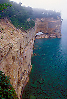 Cliffs on the Lake Superior coastline in Pictured Rocks Nationa Lakeshore between Mosquito Beach and Chapel Beach near Melstrand, Michigan.