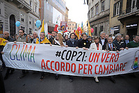 Rome Italy, 29th November 2015<br /> To coincide with the Paris United Nations Climate summit this weekend an similar marches being held across the world, ten of thousands have taken to the streets of Rome to demand action on Climate change.<br /> The Speaker of the House, Laura Boldrini (C), the ambassador of France, Catherine Colonna (white jacket)  during the People's Climate march in central Rome.