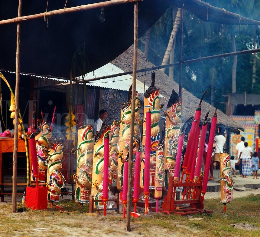 Giant incense/joss sticks burning outside Chinese Buddhist temple. West Malaysia..