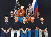 Four cosmonauts, representing two Mir crews assigned to duty aboard Russia's Mir Space Station, pose with the STS-81 crew. The cosmonauts are (top row), Valeri G. Kozun and Aleksandr Y. Kaleri (Mir-24); and (middle of second row) Gennadiy M. Manakov and Pavel V. Vinogradov (Mir 22). The astronauts are, front row (left to right) John W. Grunsfeld, Brent W. Jett, Jr., Marsha S.<br /> lvins, Michael A. Baker and Peter J. K. (Jeff) Wisoff. Flanking the Mir-22 cosmonauts on the middle row are astronauts Jerry M. Linenger (left) and John E. Blaha. All the STS-81 crew members except Blaha are scheduled to be launched in December 1996 aboard the Space Shuttle Atlantis and those six will be joined by Mir-22 cosmonaut researcher Blaha when the two spacecraft are joined in Earth-orbit. Blaha will have been launched into Earth-orbit to connect with Russia's Mir Space Station on an earlier mission - STS-79 - of the Space Shuttle Atlantis, scheduled for launch in the summer of<br /> 1996. Linenger will remain onboard Mir for a tour of duty as a cosmonaut researcher.<br /> Credit: NASA via CNP