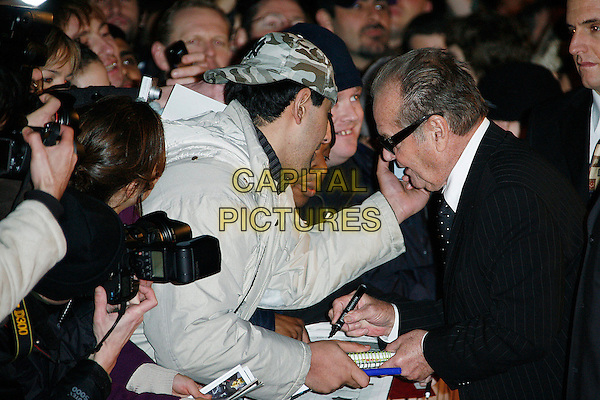 "JACK NICHOLSON.UK Premiere of ""The Bucket List"" held at the Vue cinema, Leicester Square, London, England..January 23rd, 2008    .half length black pinstripe suit profile fans crow signing autographs sunglasses shades tinted glasses funny touching face.CAP/DAR.©Darwin/Capital Pictures."