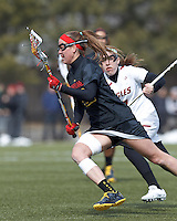 University of Maryland midfielder Beth Glaros (20) on the attack. .University of Maryland (black) defeated Boston College (white), 13-5, on the Newton Campus Lacrosse Field at Boston College, on March 16, 2013.