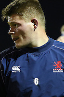 Freddie Clarke of London Scottish warms up ahead of the Greene King IPA Championship match between London Scottish Football Club and Nottingham Rugby at Richmond Athletic Ground, Richmond, United Kingdom on 16 October 2015. Photo by David Horn.