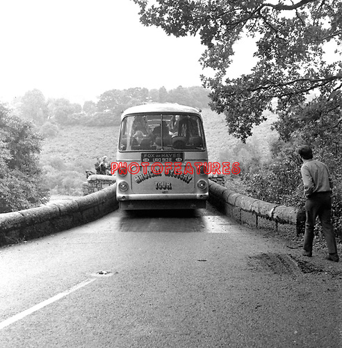 Beatles 1967 at start of Magical Mystery Tour, the bus gets stuck on a bridge.