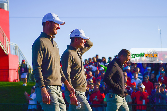 Justin Rose (GBR) and Chris Wood (ENG) depart the first tee during the Saturday morning foursomes at the Ryder Cup, Hazeltine National Golf Club, Chaska, Minnesota, USA.  10/1/2016<br /> Picture: Golffile   Ken Murray<br /> <br /> <br /> All photo usage must carry mandatory copyright credit (&copy; Golffile   Ken Murray)