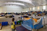 ETHIOPIA , Dire Dawa, Internal displaced people IDP camp for ethiopian Somali inland refugees from Oromo region after politcal clashes, temporary shelter in sport complex / AETHIOPIEN, Dire Dawa, IDP Camp fuer Somali Binnenfluechtlinge aus der Oromia Region sind nach politischen Unruhen provisorisch in einem Sportkomplex von der Regierung untergebracht