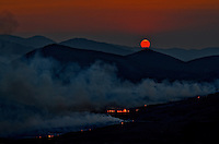 A smoke filled sky creates an ominous sunset over the Fox Den Fire near Park City, Utah.  August 2012.