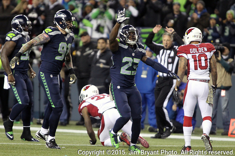 Seattle Seahawks  free safety Steven Terrell (23) celebrates with Cassius Marsh (91) after tackling Arizona Cardinals Patrick Peterson (21) during a punt return at CenturyLink Field in Seattle, Washington on November 15, 2015. The Cardinals beat the Seahawks 39-32.   ©2015. Jim Bryant photo. All Rights Reserved.