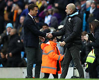 26th January 2020; Etihad Stadium, Manchester, Lancashire, England; English FA Cup Football, Manchester City versus Fulham; Fulham manager Scott Parker shakes hands with Manchester City manager Pep Guardiola at the final whistle