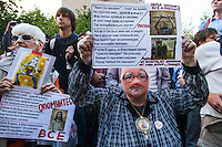 17/08/2012, Moscow, Russia..Demonstrators outside the court as Maria Alyokhina, Yekaterina Samutsevich and Nadezhda Tolokonnikova of punk band Pussy Riot are sentenced to two years prison for their performance in the Christ The Saviour Cathedral.