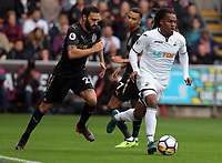 Renato Sanches of Swansea City (R) chased by Jesus Gamez of Newcastle United during the Premier League match between Swansea City and Newcastle United at The Liberty Stadium, Swansea, Wales, UK. Sunday 10 September 2017