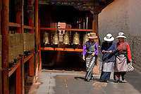 A group of women in the monestary,there are many prayer wheels in Lhasa, you always have to walk clockwise,this one is near the Potala in Lhasa