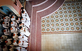VIETNAM, Cao Dai Temple in the City of Tay Ninh,  Followers in Temple waiting for Prayer, Overhead Shot