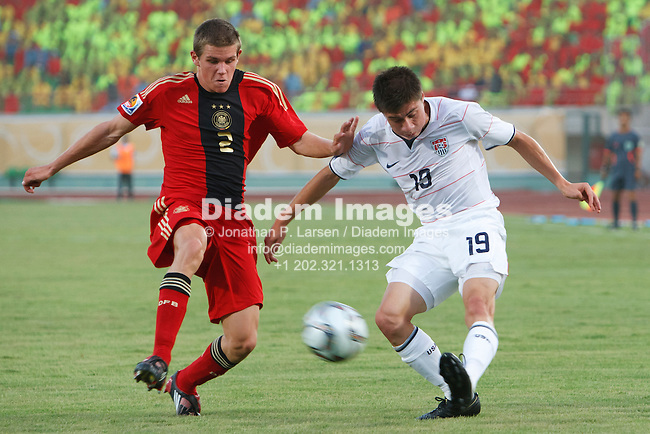 SUEZ, EGYPT - SEPTEMBER 26:  Jorge Flores of the United States (19) crosses the ball as Germany's Sebastian Jung (2) defends during a FIFA U-20 World Cup soccer match September 26, 2009 at Mubarak Stadium in Suez, Egypt.  (Photograph by Jonathan P. Larsen)