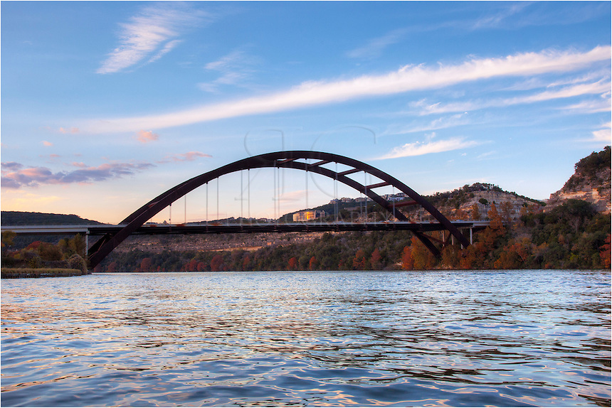 While kayaking on the river, I captured this image of the 360 Bridge from the east side of the structure. On my left is a golf course. This Pennybacker Bridge image was taken in November. You can see the trees turning gold and orange, and the afternoon was quickly fading. ..This is a fun place to spend an afternoon on the water. Boaters, fishermen, and skiers all share the waters and have a great time.