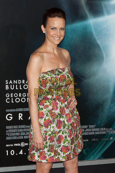 Carla Gugino<br /> The 'Gravity' premiere at AMC Lincoln Square Theater, New York City, NY., USA.<br /> October 1st, 2013<br /> half length white green red floral print dress strapless  <br /> CAP/MPI/COR<br /> &copy;Corredor99/ MediaPunch/Capital Pictures