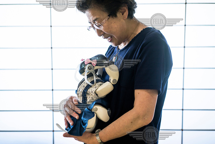 Sumie Maekawa, 73, holds her AIBO at an AIBO gathering in Tokyo. In 1999, Sony released a series of robotic pets called AIBO or Artificial Intelligence Robot. In 2006, they discontinued the AIBO line and then in 2014, discontinued all reparair services on the AIBO. A small community of AIBO owners still exists and a new repair service has emerged to help keep the AIBOs running.