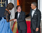 United States President Barack Obama and first lady Michelle Obama welcome President Francois Hollande of France to a State Dinner in his honor on the North Portico of the White House in Washington, D.C. on Tuesday, February 11, 2014.<br /> Credit: Ron Sachs / CNP