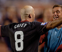 Conor Casey is congratulated after scoring one of two goals against Honduras as the USA clinches a spot in the  2010 World Cup after defeating Honduras in 3-1 during CONCACAF qualifying in San Pedro Sula, Honduras, October 10, 2009.