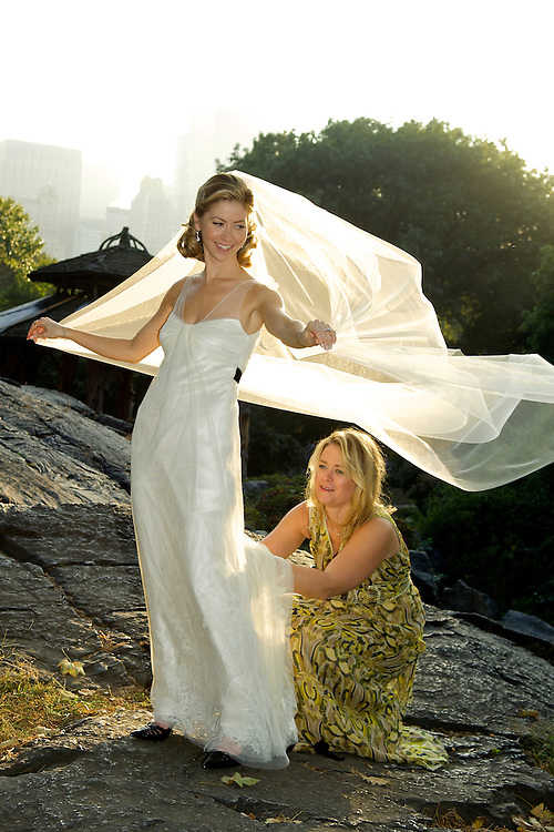 Bride & bridesmaid in Central Park, veil blowing in the wind.