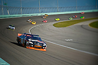 Denny Hamlin (#11) slipped out in front of Jimmie Johnson (#48) breifly before going a lap down late in the race.