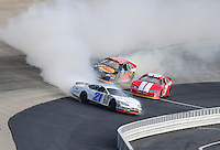 Sept 19, 2008; Dover, DE, USA; NASCAR Camping World Series East driver Jonathan Smith (21) crashes during the Sunoco 150 at Dover International Speedway. Mandatory Credit: Mark J. Rebilas-