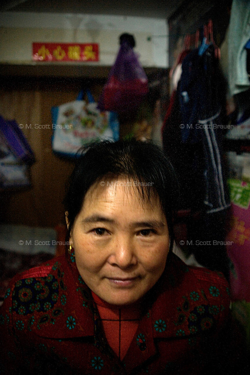 Inside the dormitory of Pei Yaling, 50, an ayi (or housekeeper) from Anhui Province working in Nanjing, Jiangsu, China.  She makes less than $200 a month.
